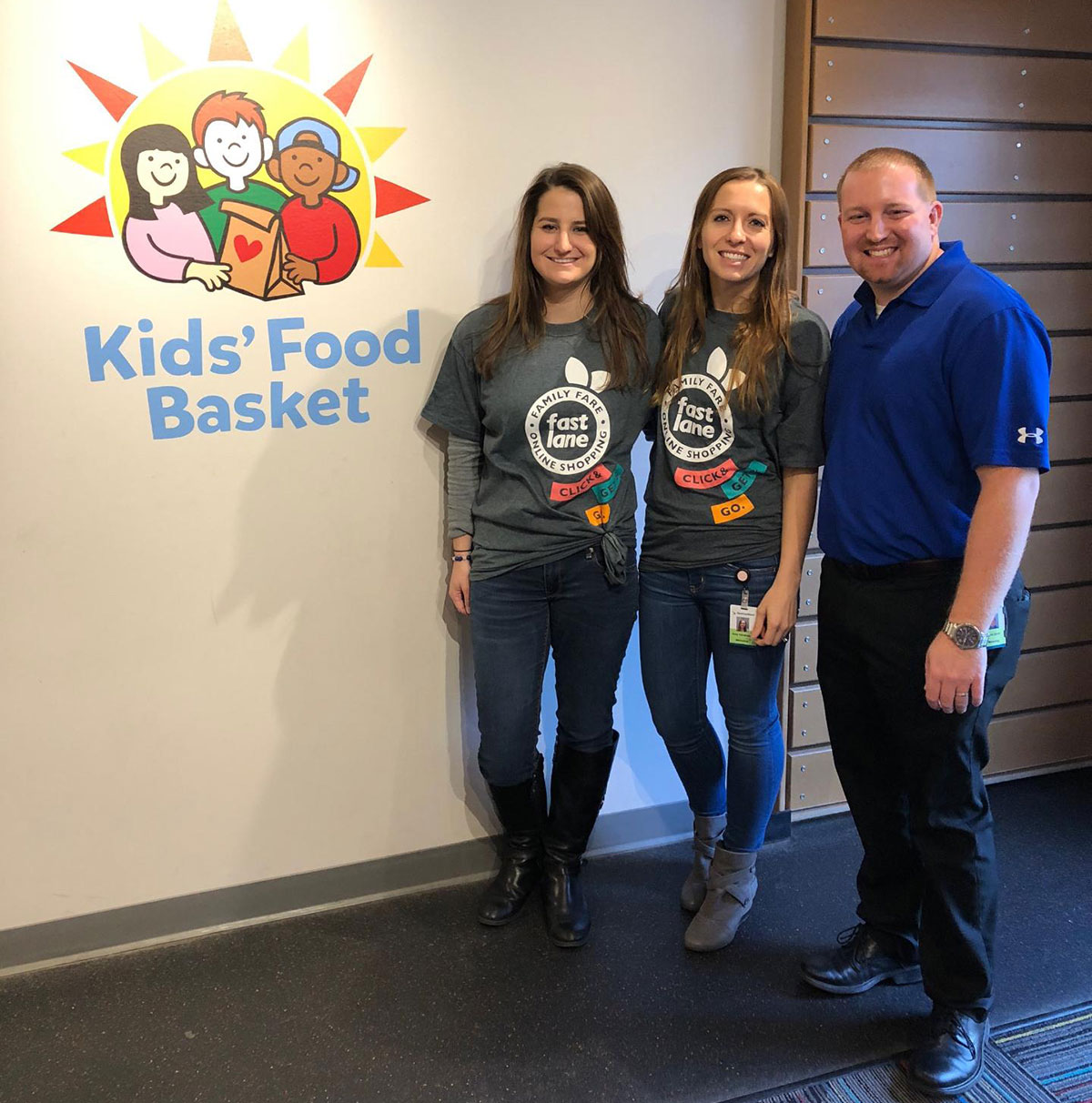 SpartanNash employees helping at the kid's food basket