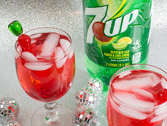 Holiday party drink with 7up and red maraschino cherries