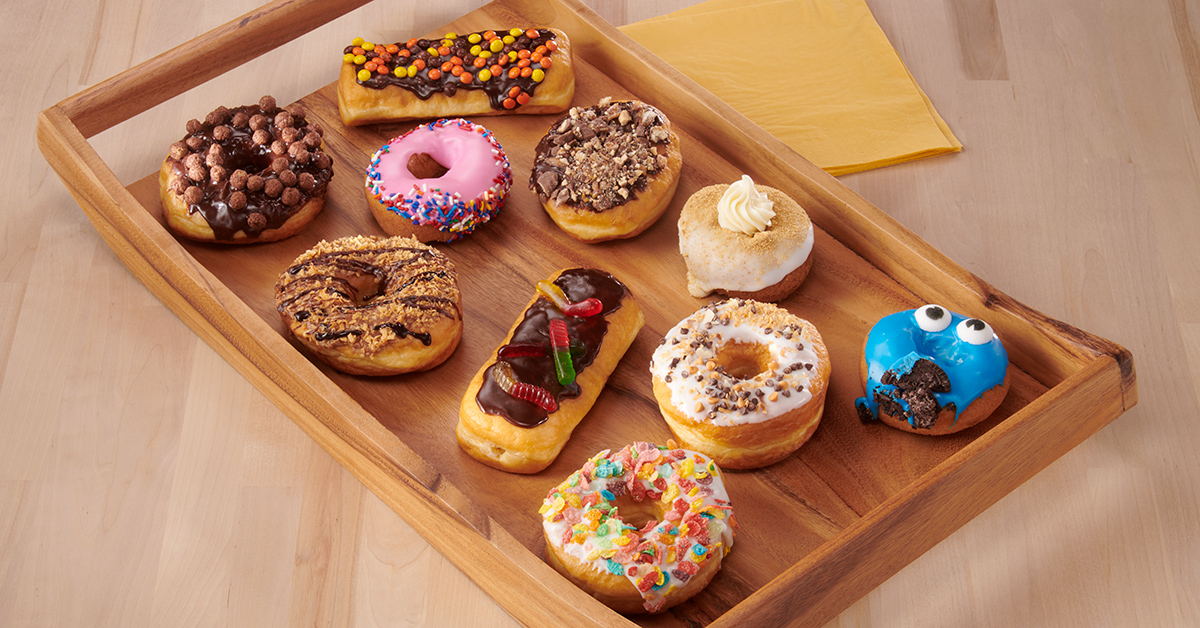 Wooden tray with a variety of Donut Dohjo brand donuts