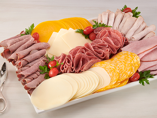 platter with slices of various kinds of cheeses