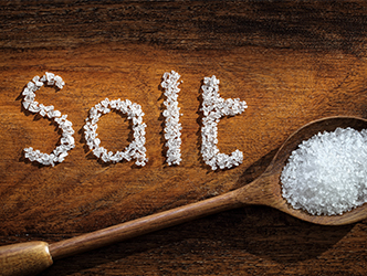Salt spelled in salt with spoon of salt