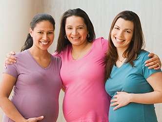 Three pregnant women