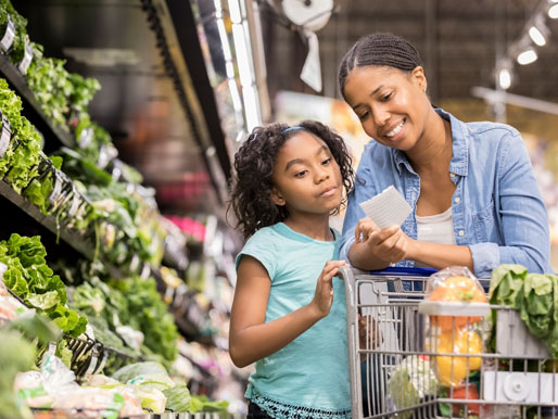 Mom and daughter looking at grocery list