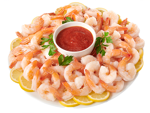Plate with shrimp, cocktail sauce and lemon wedges