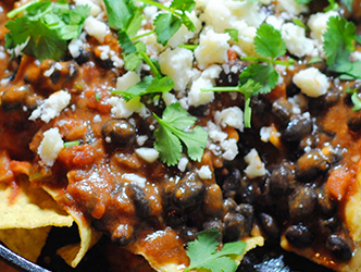 eggs cooked with salsa, black beans, tortilla chips and cheese