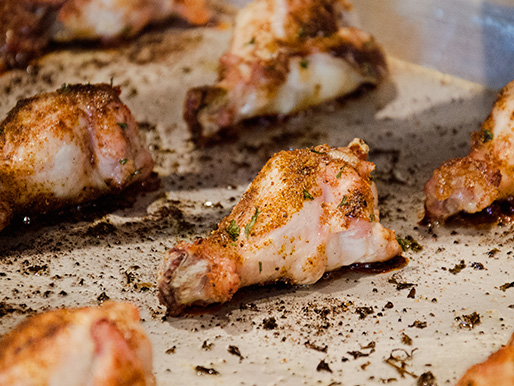 Slow baking is the secret to a tasty and healthy Family Fare chicken wing recipe, shown here ready to be removed from the oven and enjoyed.