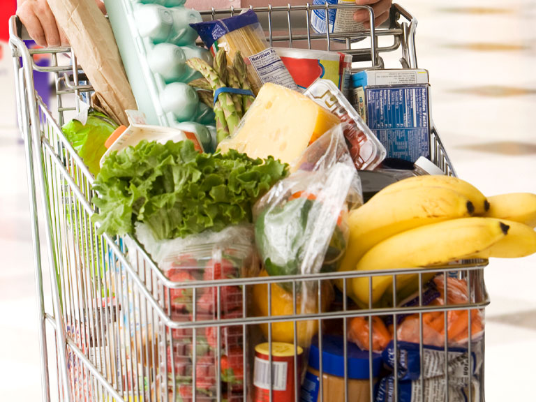 grocery cart full of groceries