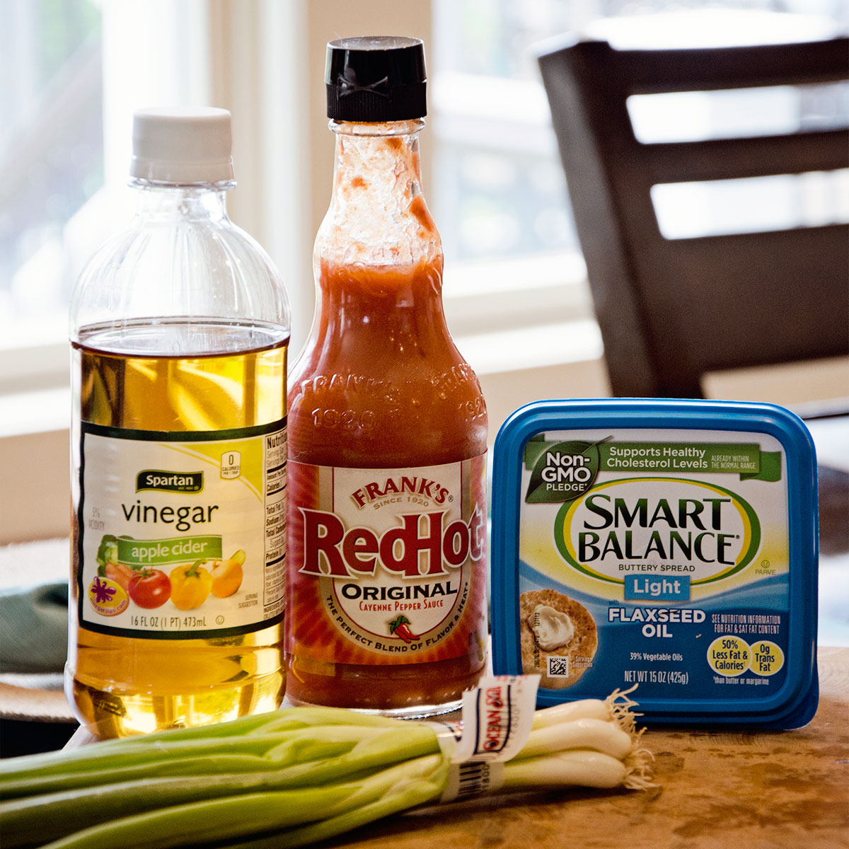 A table displaying how to finish off your healthy chicken wing recipe with tasty sauces like Spartan Vinegar, Frank's RedHot, and SmartBalance Buttery Spread