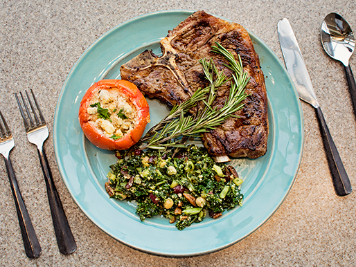 Crushed Garlic T-Bone Steaks recipe with roquefort tomatoes tempt the eye on a plate served for one.